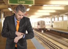 Train delay. Businessman looking at his watch Royalty Free Stock Photography