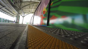 Train Departing from the Station. Low-angle shot of a train departing from the station stock video footage