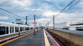 Train departing from Tambaguchi station stock image