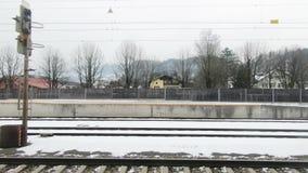 A train departs Golling-Abtenau Station in Austria. The view from a train as it departs Golling-Abtenau Station in Austria hd, 30fps stock video