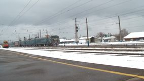 Train departs from the platform. Passenger train departs from platform winter stock footage