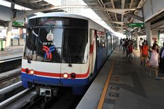 Train Departs a Station in Bangkok Stock Photo