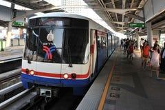 Train Departs a Station in Bangkok Stock Photo