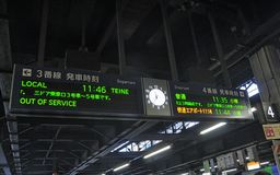 Train departure  time sign post at Sapporo Station Royalty Free Stock Photography