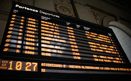 Train departures board. On the railroad station Royalty Free Stock Photo