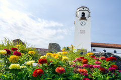 Train depot tower and summer flowers Royalty Free Stock Photography