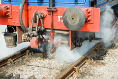 Train detail on railway track. With steam royalty free stock photography