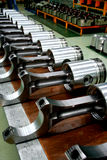 Train diesel engine pistons on the product line. A group of big train diesel engine pistons on the product line Stock Photos