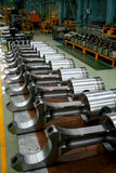 Train diesel engine pistons on the product line. A group of big train diesel engine pistons on the product line Stock Photo