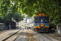 Train Diesel railcar through neighborhoods of railroad community. BANGKOK, THAILAND - 23 Feb 2018 : Train Diesel railcar Daewoo departing from Bangkok Station Stock Images