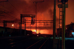 Train disaster in Viareggio,Italy. 30/06/2009.VIAREGGIO,ITALY: flames and fire high in a red sky after the explosion of the train full of gpl stock photo