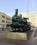Train on display. An old steam locomotive on display in a city stock photography