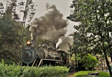 Train at Dollywood in Tennessee. Smoke billows from the engine of the train at Dollywood in Pidgeon Forge, Tennessee Royalty Free Stock Photography