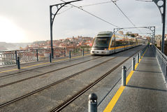 Train on Dom Luis Bridge (Porto) Royalty Free Stock Photos