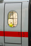 Train door. A man mirroring in a door of a german ice train stock photos