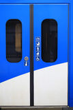 Train door. Blue train door closed with signs Royalty Free Stock Photo