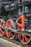 Train drive mechanism and red wheels of an old  steam locomotive Stock Photo