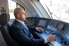Train driver in cabin royalty free stock photo