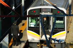 Train drivers. Japanese train drivers changing shift on JR train station in Niigata royalty free stock photography