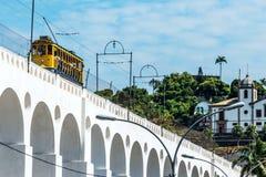 Train drives along distinctive white arches of the landmark Lapa Stock Photo