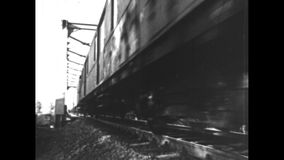 Train drives away. Black and White. A train drives away from the camera stock video footage