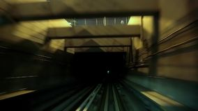 Train drives into tunnel stock video footage