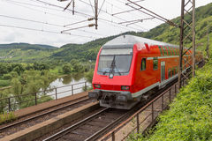 Train driving along german river Moselle. Train driving along river Moselle in Germany Royalty Free Stock Image