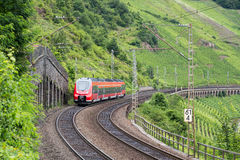 Train driving along german river Moselle Royalty Free Stock Photography
