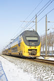 Train driving in the countryside from Netherlands in winter Stock Photography