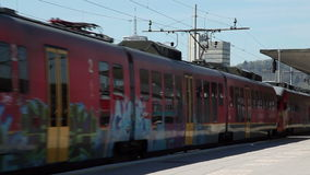 Train driving pass trainstation in Ljubljana stock footage