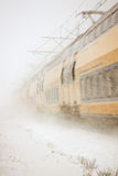 Train driving in severe snowstorm Royalty Free Stock Photos