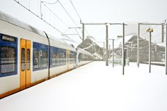 Train driving in snowstorm in the Netherlands Royalty Free Stock Image
