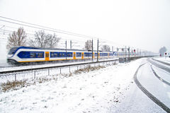 Train driving in a snowstorm in the Netherlands Royalty Free Stock Photography