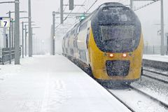 Train driving in snowstorm in winter in Amsterdam Netherlands Royalty Free Stock Image