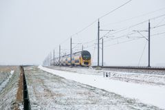 Train in Dutch rural winter landscape Stock Photos