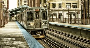 Train on elevated tracks within buildings at the Loop, Chicago City Center - Black Gold Artistic Effect - Chicago, Illinois. USA Stock Image