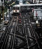 Train on elevated tracks within buildings at the Loop, Chicago City Center - Bleached Portrait Artistic Effect - Chicago, Illinois. USA Royalty Free Stock Photos