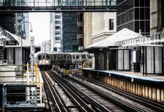 Train on elevated tracks within buildings at the Loop, Chicago City Center - Bleached Portrait Artistic Effect - Chicago. Illinois, USA Stock Photography