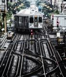 Train on elevated tracks within buildings at the Loop, Chicago City Center - Bleached Portrait Artistic Effect. Chicago, Illinois, USA Stock Images