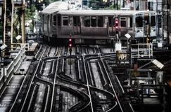 Train on elevated tracks within buildings at the Loop, Chicago City Center - Bleached Portrait Artistic Effect. Chicago, Illinois, USA Royalty Free Stock Photo