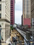 Train on elevated tracks within buildings at the Loop, Chicago City Center - Chicago, Illinois. USA Royalty Free Stock Image