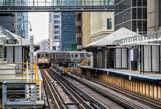 Train on elevated tracks within buildings at the Loop, Chicago City Center - Chicago. Illinois, USA Royalty Free Stock Image