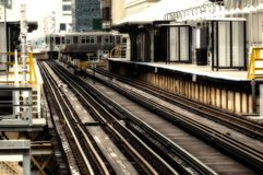 Train on elevated tracks within buildings at the Loop, Chicago City Center - Sepia Glow Artistic Effect. Chicago, Illinois, USA Stock Photos