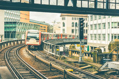 Train on elevated tracks coming to the station in Hamburg Royalty Free Stock Image
