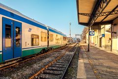 Train on empty station in Alba, Italy. Royalty Free Stock Image