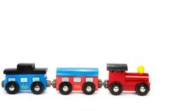 Train en bois de jouet avec les blocs colorés d'isolement Photo libre de droits