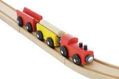 Train en bois de jouet sur le longeron Photos stock