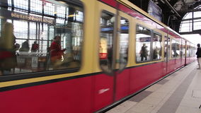 Train entering the station in Berlin. People entering train at the station in Berlin stock footage