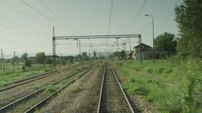 A train entering a trainstation. An on board shot of a train entering a trainstation stock video