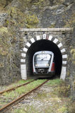 Train exit from railway stone  tunnel Royalty Free Stock Images